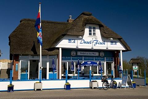 Thatched house, Insel-Fisch restaurant, Norderhafen harbor, Nordstrand island, Schleswig-Holstein, Germany, Europe