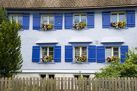 House facade with shutters and flower arrangements, Appenzell, region of Appenzell, Switzerland, Europe