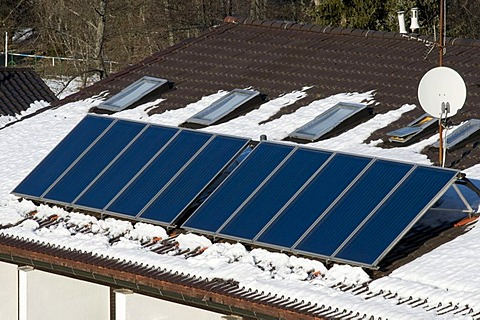 Roof with solar cells and patches of snow, Bayerisch Eisenstein, Bavarian Forest, Bavaria, Germany, Europe