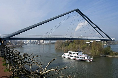 Pedestrian bridge and excursion boat on the Rhine, Medienhafen, Media Harbour, Duesseldorf, state capital of North Rhine-Westphalia, Germany, Europe