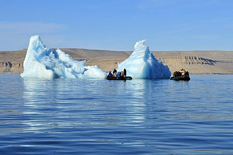 Zodiac with cruiseship passengers near an iceberg at Crocker Bay, Devon Island, Northwest Passage, Nunavut, Canada, Arctic