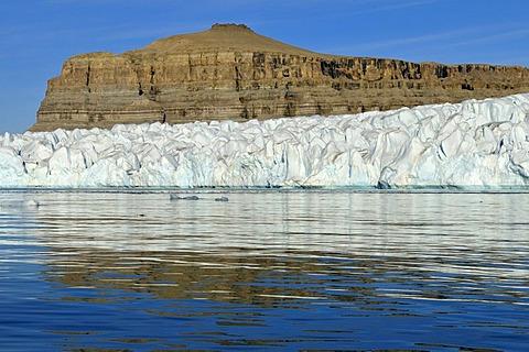 Sedimentary rocks and glacier at Crocker Bay, Devon Island, Northwest Passage, Nunavut, Canada, Arctic