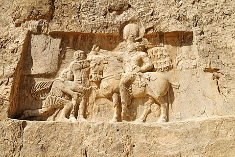 Sassanid relief of the triumph of King Shapur I. over the Roman Emperor Valerian and Philip the Arab at the Achaemenid burial site Naqsh-e Rostam, Rustam near the archeological site of Persepolis, UNESCO World Heritage Site, Persia, Iran, Asia