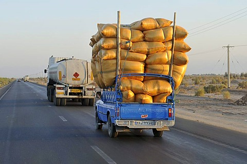 Iranian pickup truck overloaded with sacks on a highway, Iran, Persia, Asia