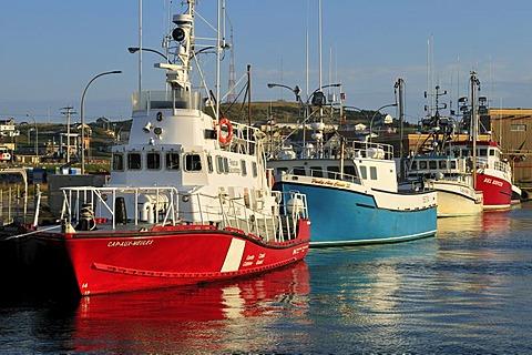 Coastguard ship and fishing boat in the harbour of Ile du Cap aux Meules, Iles de la Madeleine, Magdalen Islands, Quebec Maritime, Canada, North America