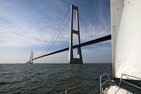 Sail yacht right before passing under the StorebÊlt Bridge, Great Belt Bridge, Korsoer, Zealand, Denmark, Europe