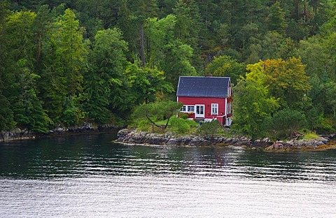 A typical Norwegian wooden house on the coast off Bergen, Norway, Scandinavia, Northern Europe