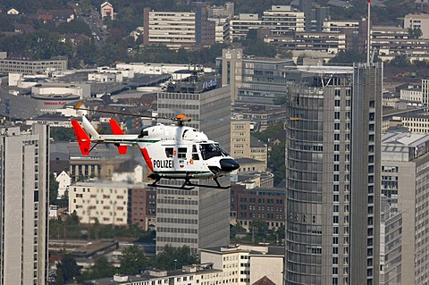BK 117 police helicopter of the North Rhine-Westphalian police flying squadron during a mission flight, downtown Essen, North Rhine-Westphalia, Germany, Europe