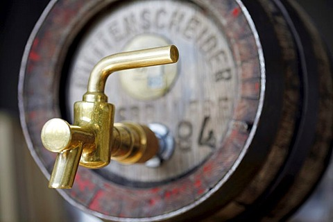 Wood beer keg in a small private brewery, with brass tap