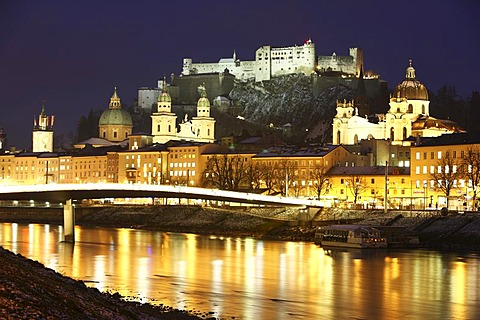 Old town with Kollegienkirche church, the Salzburger Dom cathedral and Festung Hohensalzburg fortress, Salzach river, at night, winter, Salzburg, Austria, Europe