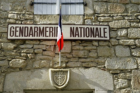 Gendarmerie with flag, fortified cliff town Rocamadour, Departement Lot, Midi-Pyrenees, France, Europe