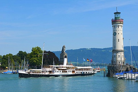 Harbor entrance with paddlewheel steamer Hohentwiel in Lindau, Lake Constance, Bavaria, Germany, Europe