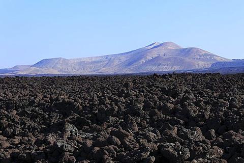 Sea of lava in Timanfaya National Park, Caldera Blanca at back, Lanzarote, Canary Islands, Canary Islands, Spain, Europe