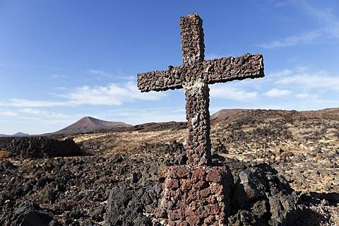Cross made of volcanic rocks near Los Cocoteros, Lanzarote, Canary Islands, Spain, Europe