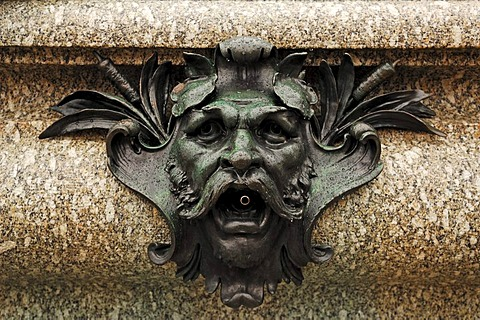 Face as a gargoyle on a fountain at the Marktplatz square, Erlangen, Middle Franconia, Bavaria, Germany, Europe