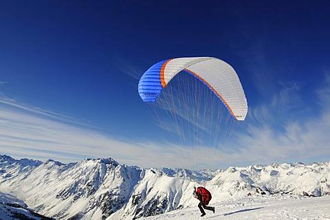 Paraglider at take-off, Pardorama Mountain, Ischgl ski resort, Tyrol, Austria, Europe