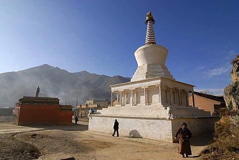 Two Tibetan women circling a stupa of the Labrang monastery, Xiahe, Gansu, China, Asia