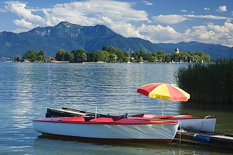 Paddle boats at Gstadt, view to Fraueninsel island, Chiemsee lake, Chiemgau, Upper Bavaria, Bavaria, Germany, Europe