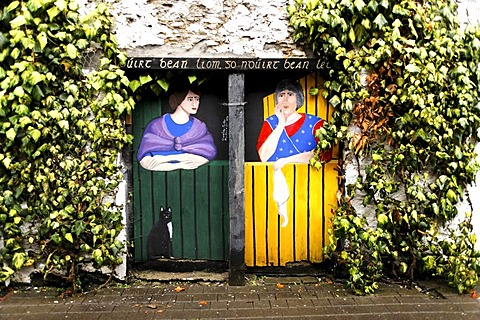 Painting of two women on wooden doors, Killarney, Ireland, Europe