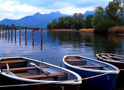 Small boats moored on the Chiemsee lake and Bavarian Alps, Chiemgau, Upper Bavaria, Germany, Europe
