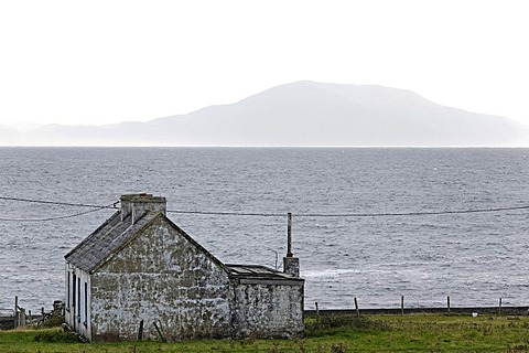 Coastal cottage and Achillbeg island, Achill, County Mayo, Ireland, Europe