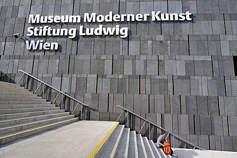 Man on stairs outside Museum Moderner Kunst, MUMOK, Museum of Modern Art building, MuseumsQuartier in Vienna, Austria, Europe