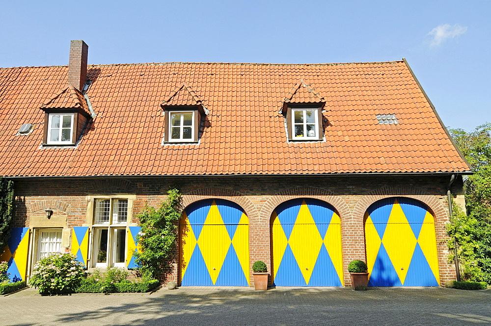 Yellow and blue doors, Westpreussisches Landesmuseum West Prussian State Museum, Drostenhof, Wolbeck, Muenster, Muensterland region, North Rhine-Westphalia, Germany, Europe