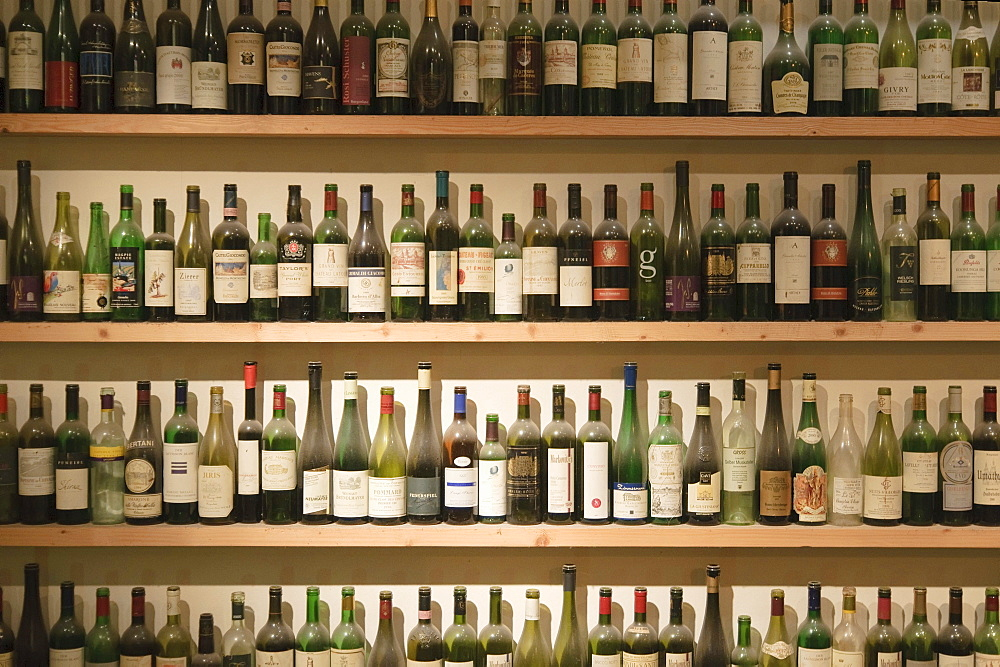 Many empty wine bottles on the shelves in the window of a wine restaurant, Vienna, Austria, Europe
