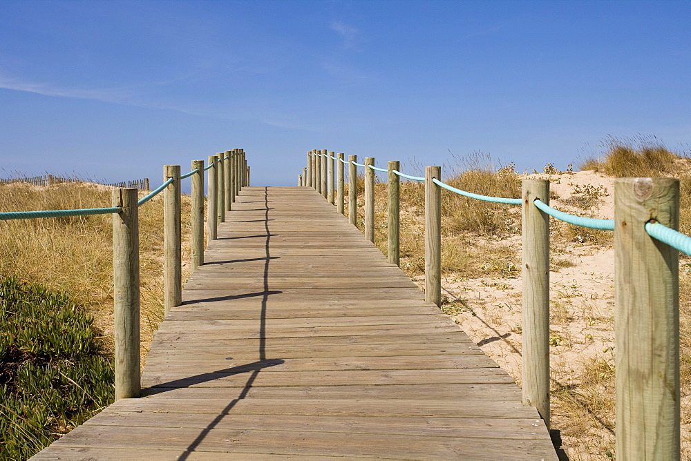 Wooden way in the beach