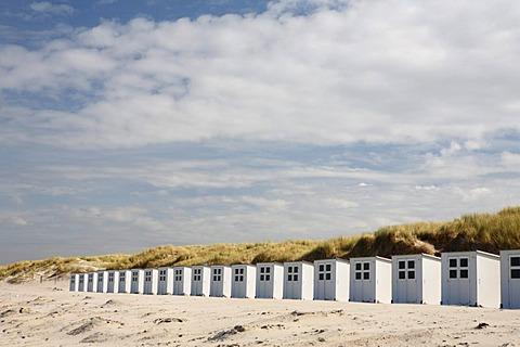 Wooden beach huts against a blue sky, beach, near the nature reserve De Slufter, Texel, The Netherlands, The Netherlands, Europe