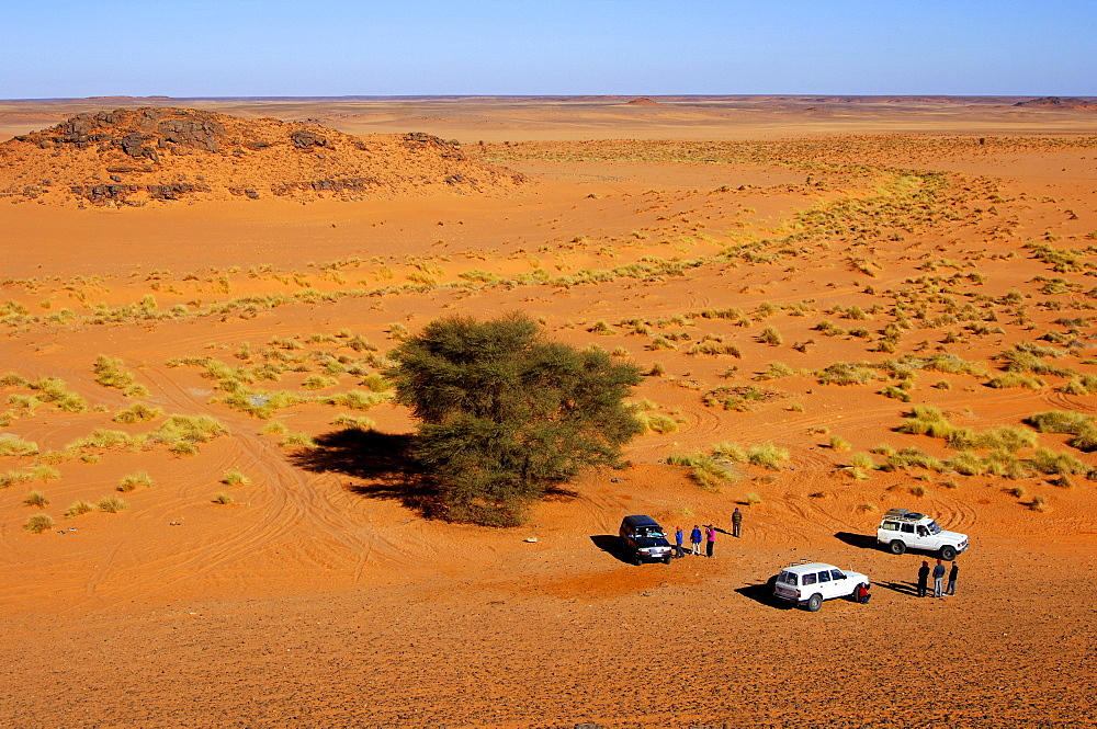 Three jeeps with tourists lost on a trip in the depths of the Sahara, Libya, Africa
