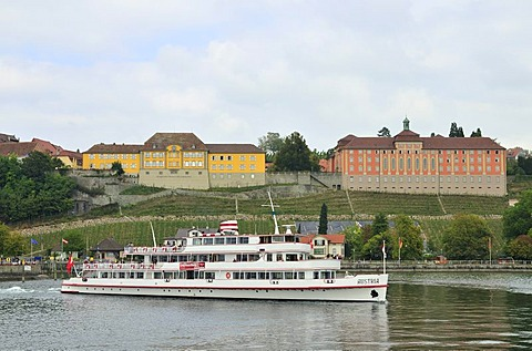 A boat in Meersburg harbour in front of the State Vineyards and Droste Huelshoff Gymnasium high school, Lake Constance, Baden-Wuerttemberg, Germany, Europe