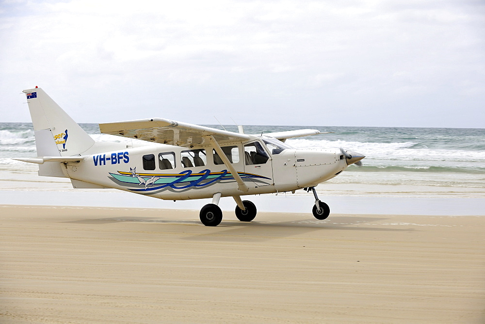 Aircraft taking off on Seventy-Five Mile Beach, an official highway, the world's only official beach airport on a sand runway, UNESCO World Natural Heritage Site, Fraser Island, Great Sandy National Park, Queensland, Australia
