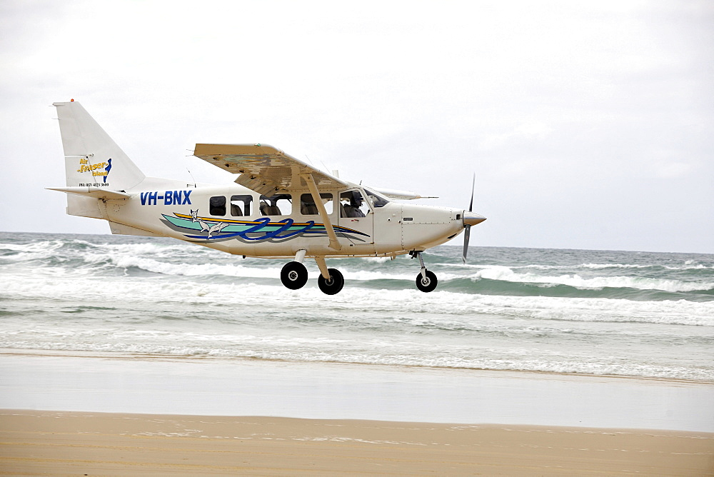 Aircraft landing on Seventy-Five Mile Beach, an official highway, the world's only official beach airport on a sand runway, UNESCO World Natural Heritage Site, Fraser Island, Great Sandy National Park, Queensland, Australia