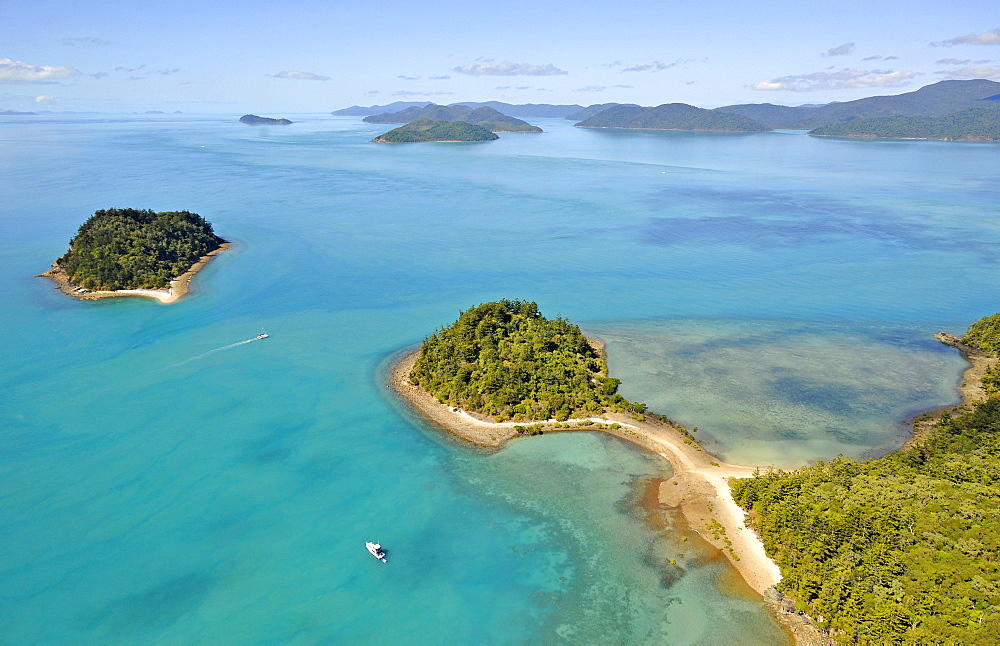 Aerial view of Pelican Island peninsula off Long Island, far left East Rock, Whitsunday Islands National Park, Queensland, Australia