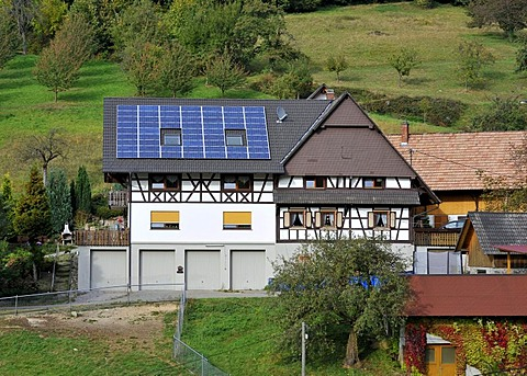 Solar panels on the roof of a house, farm, Gasthof Benz-Muehle inn, Ottenhoefen, Muehlenrundweg, Black Forest, Baden-Wuerttemberg, Germany, Europe