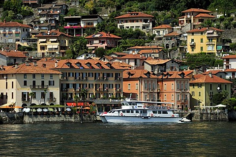 View towards a town with a tourist ferry over Lake Maggiore, Cannero Riviera, Piedmont, Italy, Europe