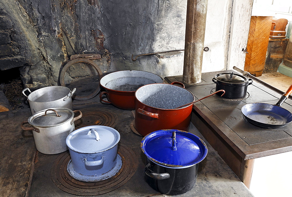 Pots on an old wood stove, kitchen in the Haus Andrinet house from 1740, Wolfegg farmhouse museum, Allgaeu region, Upper Swabia, Baden-Wuerttemberg, Germany, Europe