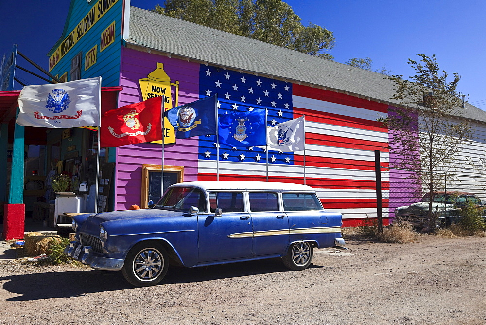 Souvenir shop and vintage car on the historic Route 66, Antares, Kingman, Arizona, USA, North America