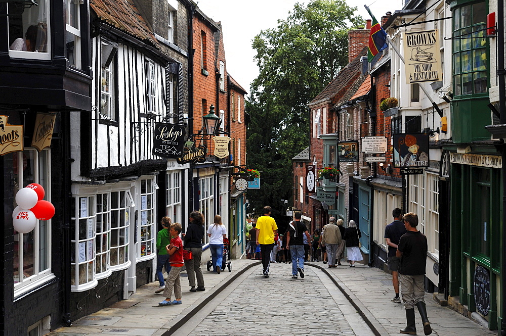 Old shopping street with old houses, Steep Hill, Lincoln, Lincolnshire, England, UK, Europe