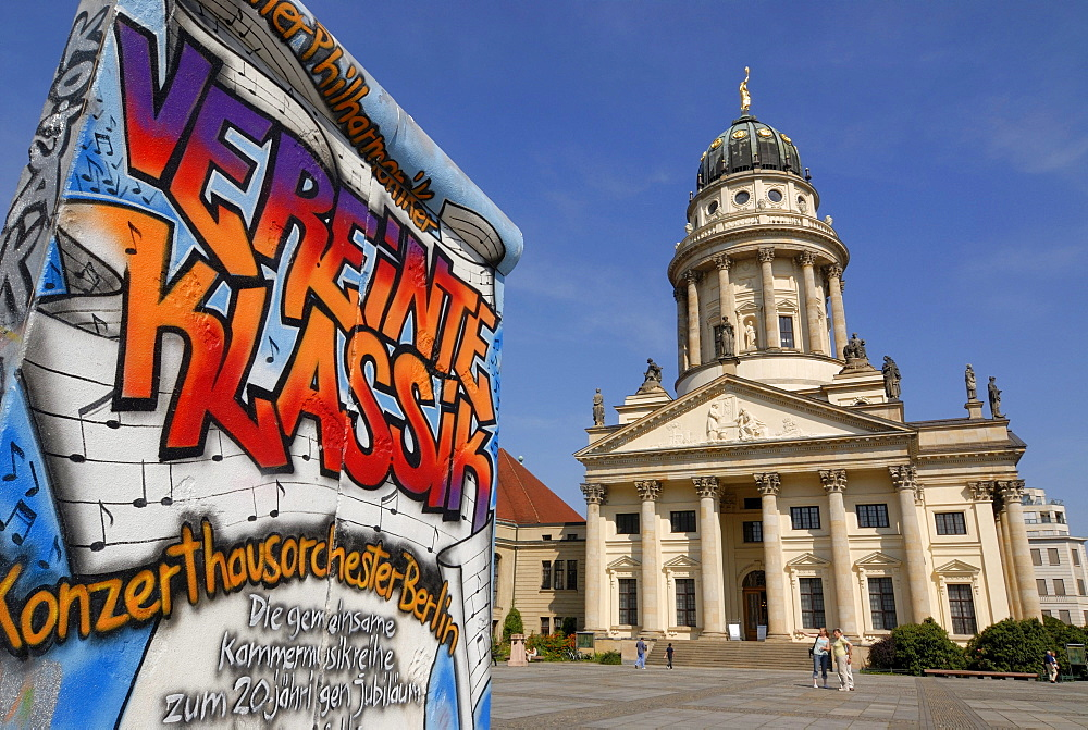 Graffiti as advertising on a piece of the Berlin Wall, French Cathedral, Gendarmenmarkt, Berlin, Germany, Europe