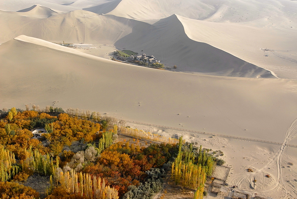 Aerial view of Crescent Lake and the giant sand dunes in the Gobi Desert, Silk Road, Dunhuang, in Gansu, China, Asia