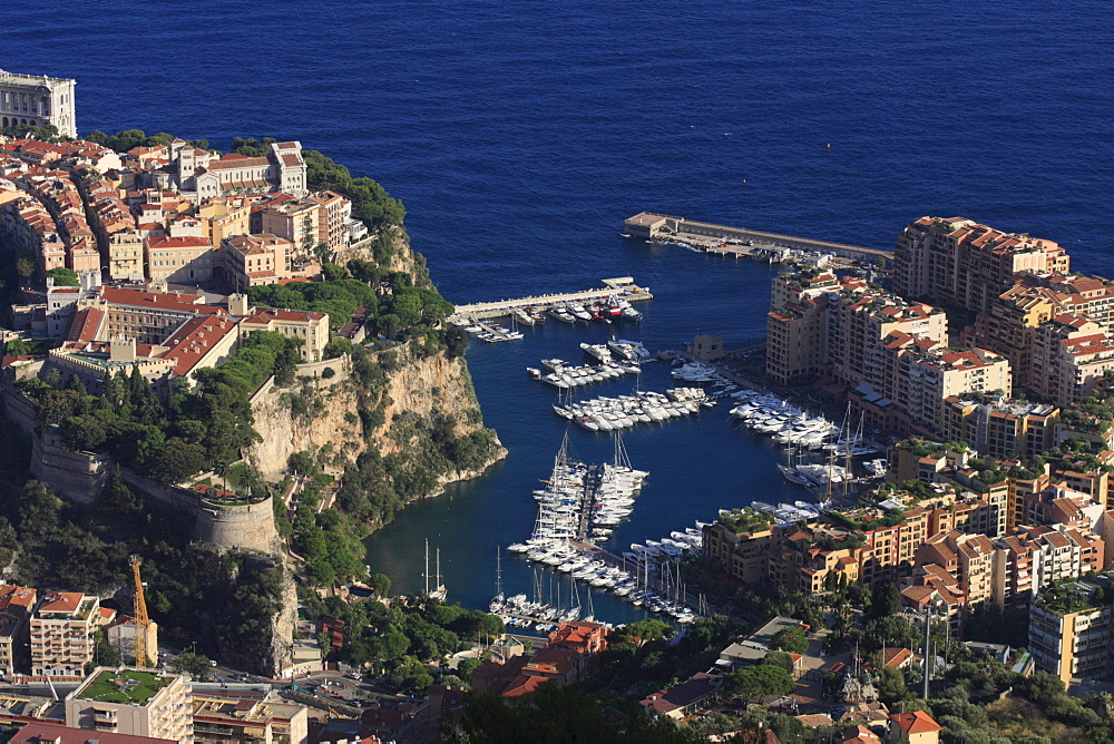 Port Fontvieille with superyachts between the historic town centre of Monaco with Prince's Palace and the Cathedral and the newer district of Fontvieille, Principality of Monaco, Cote d'Azur, Europe