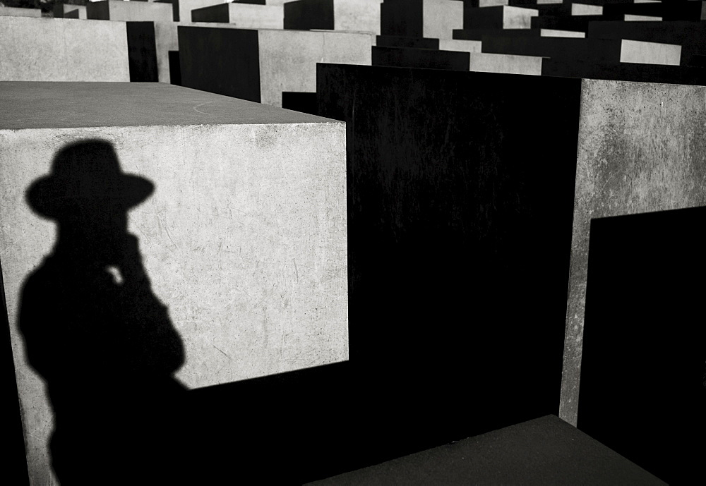 Shadow of a person wearing a hat, Stelae Field, Holocaust Memorial, Berlin, Brandenburg, Germany, Europe