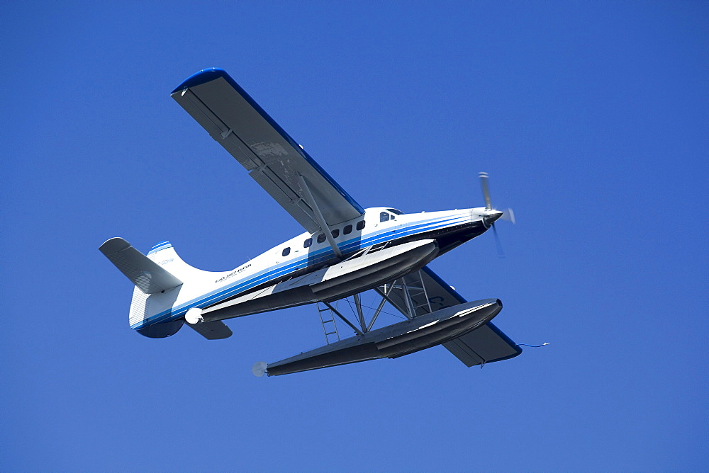 Flying de Havilland Canada DHC-3 Otter, Floatplane, bush plane, Caribou Lakes, upper Liard River, Yukon Territory, Canada