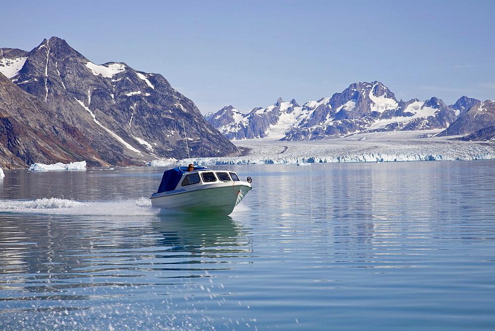 Transportation boat in the Sermiligaq fjord, in the back the Knud Rasmussen Glacier, East Greenland, Greenland, Denmark