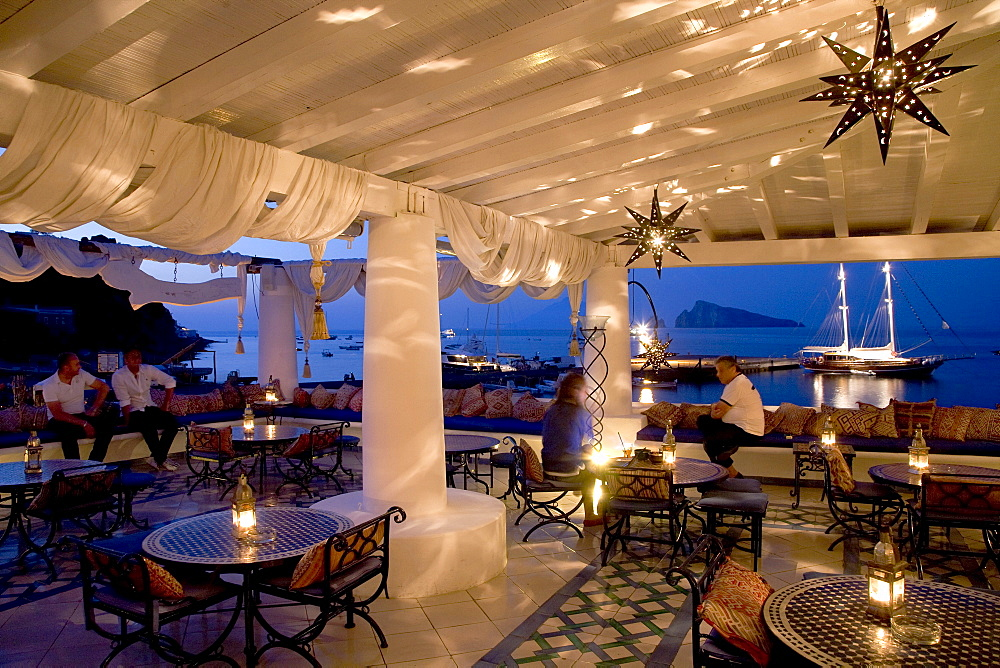 """""""Lisca Blanca"""" chill out club, terrace at the harbor of Panarea island, Aeolian Islands, Sicily, Italy, Europe"""