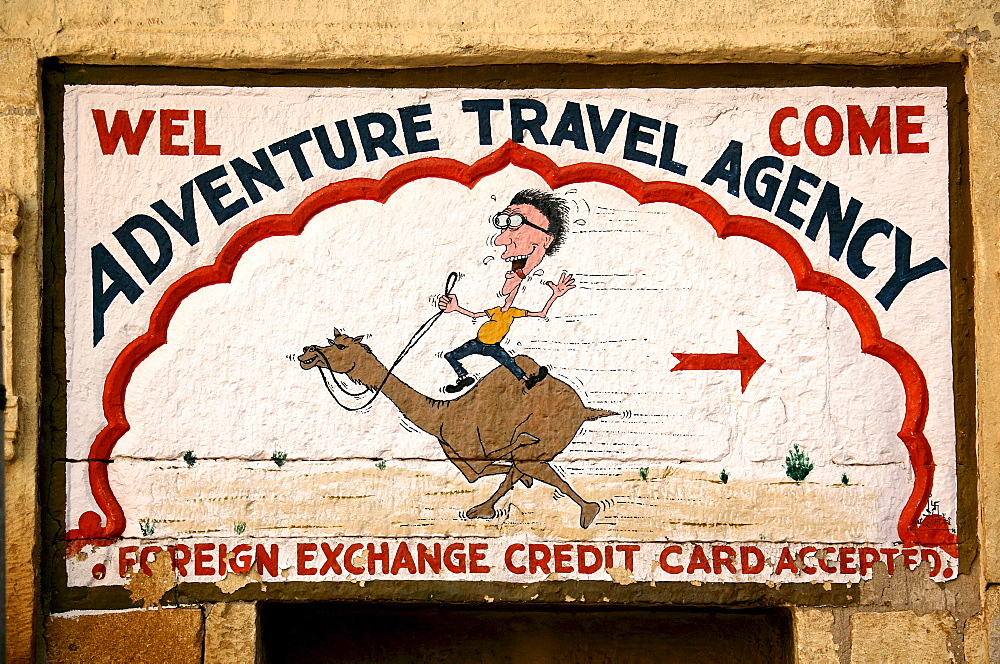 Advertising sign of an Indian travel agent for a camel safari in Jaisalmer, Rajasthan, India, Asia