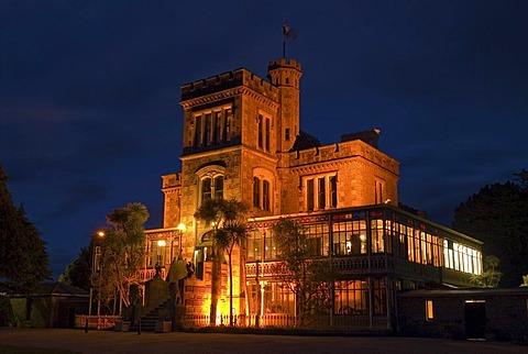 Larnach Castle on the Otago Peninsula illuminated by floodlight, New Zealand