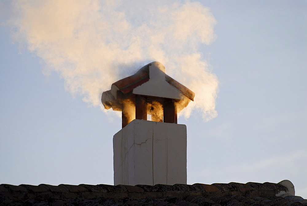 A fuming chimney in warm morning light, Ronda, Andalusia, Spain, Europe